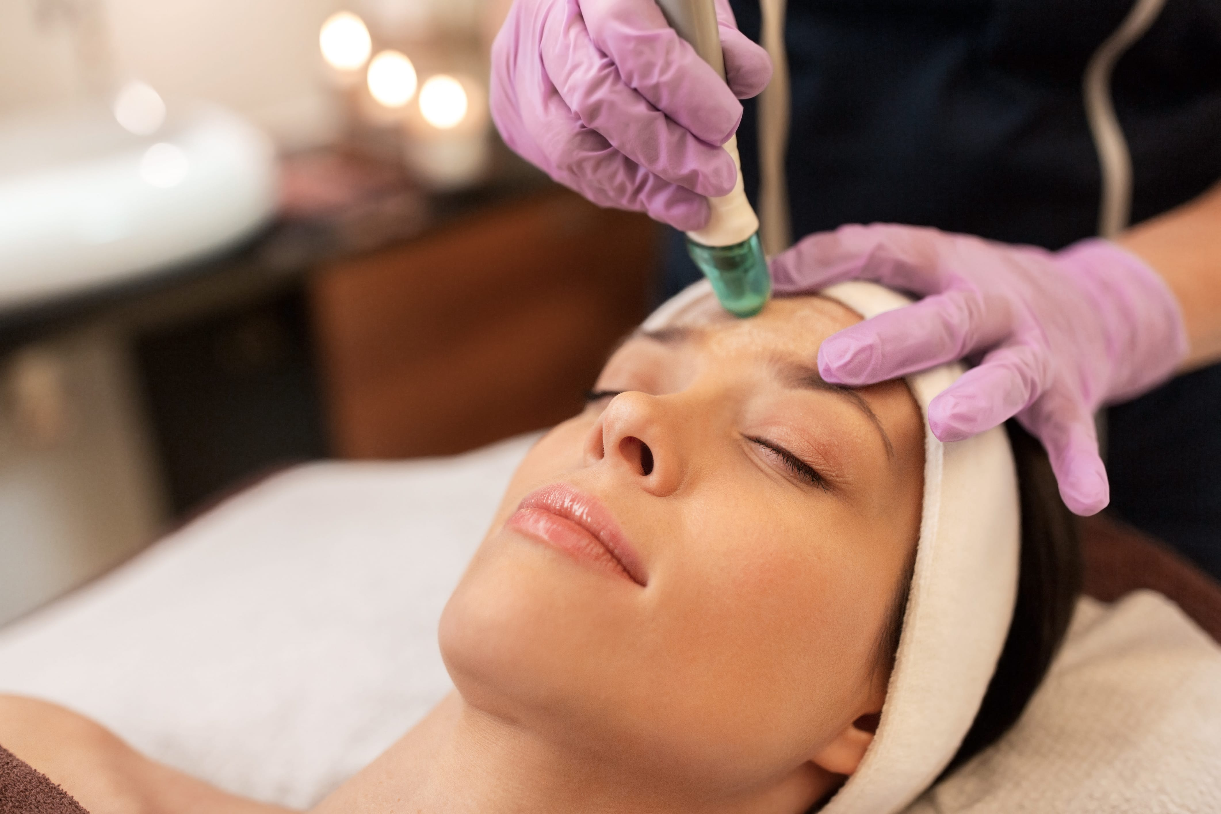 woman having microdermabrasion facial treatment